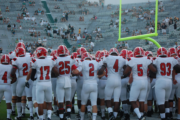 The Youngstown State football team huddles together before its battle with Michigan State on Sept. 2, 2011. The Penguins will return to Spartan Stadium on Saturday for another game with the Spartans. Jambar file photo.