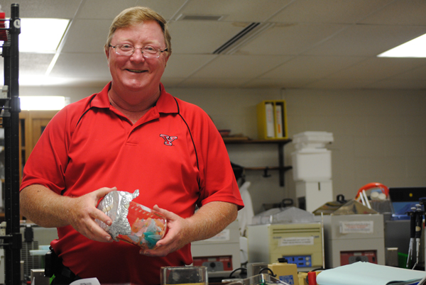Dr. Chet Cooper, an associate professor of biology, runs his laboratory in Ward Beecher Hall. Cooper is also the NCAA Faculty Athletics Representative for the University. Photo by Josh Medore/ The Jambar.
