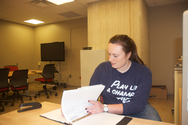 Sarah Chill manages Youngstown State University's new Corporate Communication Consulting Center, ConneX. This communication center, located in the basement of Maag library, is expected to establish relationships between the university and local businesses.  Photo by Frank George/The Jambar.
