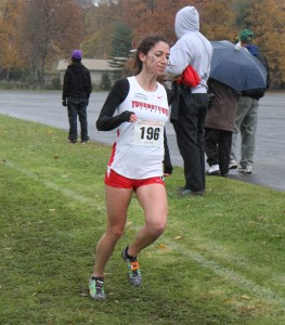 Anna Pompeo runs during Saturday's Horizon League championships in Boardman. The YSU women's cross country team won their first title, while the men's team finished second. Photo courtesy of YSU sports information.