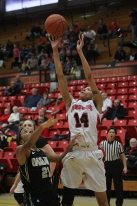 Karen Flagg attempts a jump shot over Oakland's Nola Anderson at Beeghly Center on Saturday. Flagg finished with 11 points and nine rebounds in Youngstown State's 79-64 victory. Photo by Dustin Livesay/The Jambar
