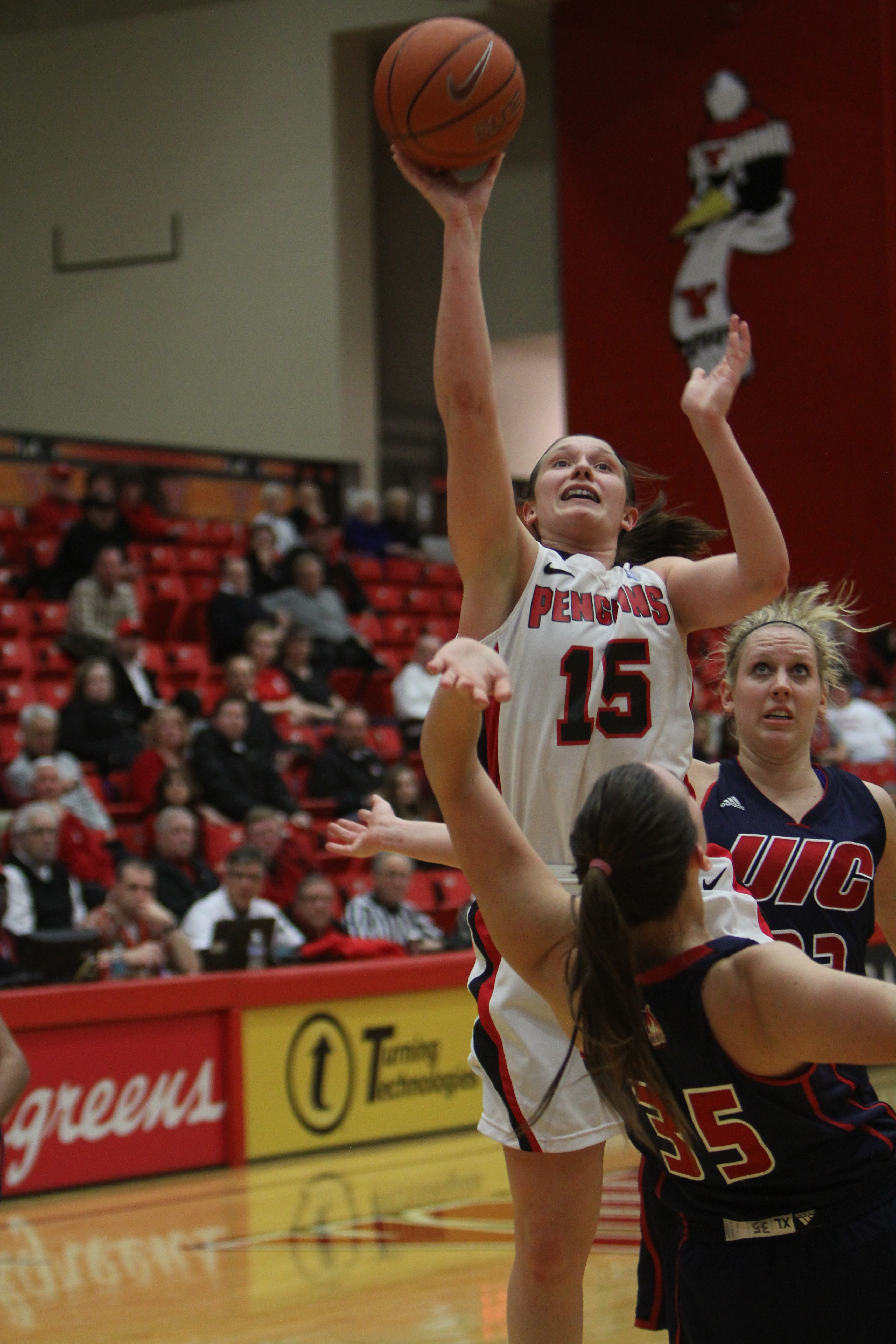 Youngstown State's Heidi Schlegel (15) puts up a jumper while being defended by UIC's Katie Hannemann (35) during the first half of Thursday night's loss at the Beeghly Center. Photo by Dustin Livesay/ The Jambar.