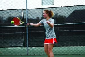 Mararita Sadovnikova returns a serve in practice. Sadovnikova, a senior, has been named to a First Team All-Horizon League player three times.