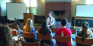Youngstown Mayor John McNally speaks to a crowd of scholars and honors students during an event at the Cafaro House dormitiories on April 1.