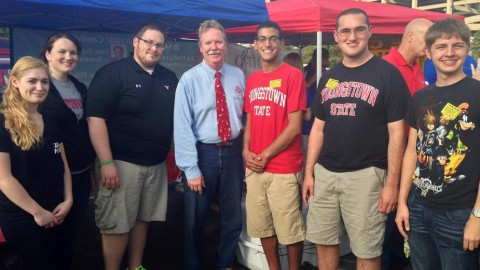 Tom Letson (center-left), a Democrat member of the Ohio House of Representatives and current candidate for a seat on the Supreme Court of Ohio, stands with Ernie Barkett (center-right), president of the newly re-formed College Democrats, at a recent YSU tailgate. Though member numbers began to dwindle after the 2012 presidential election, the upcoming November elections brought new life into the group. photo courtesy of Ernie Barkett.