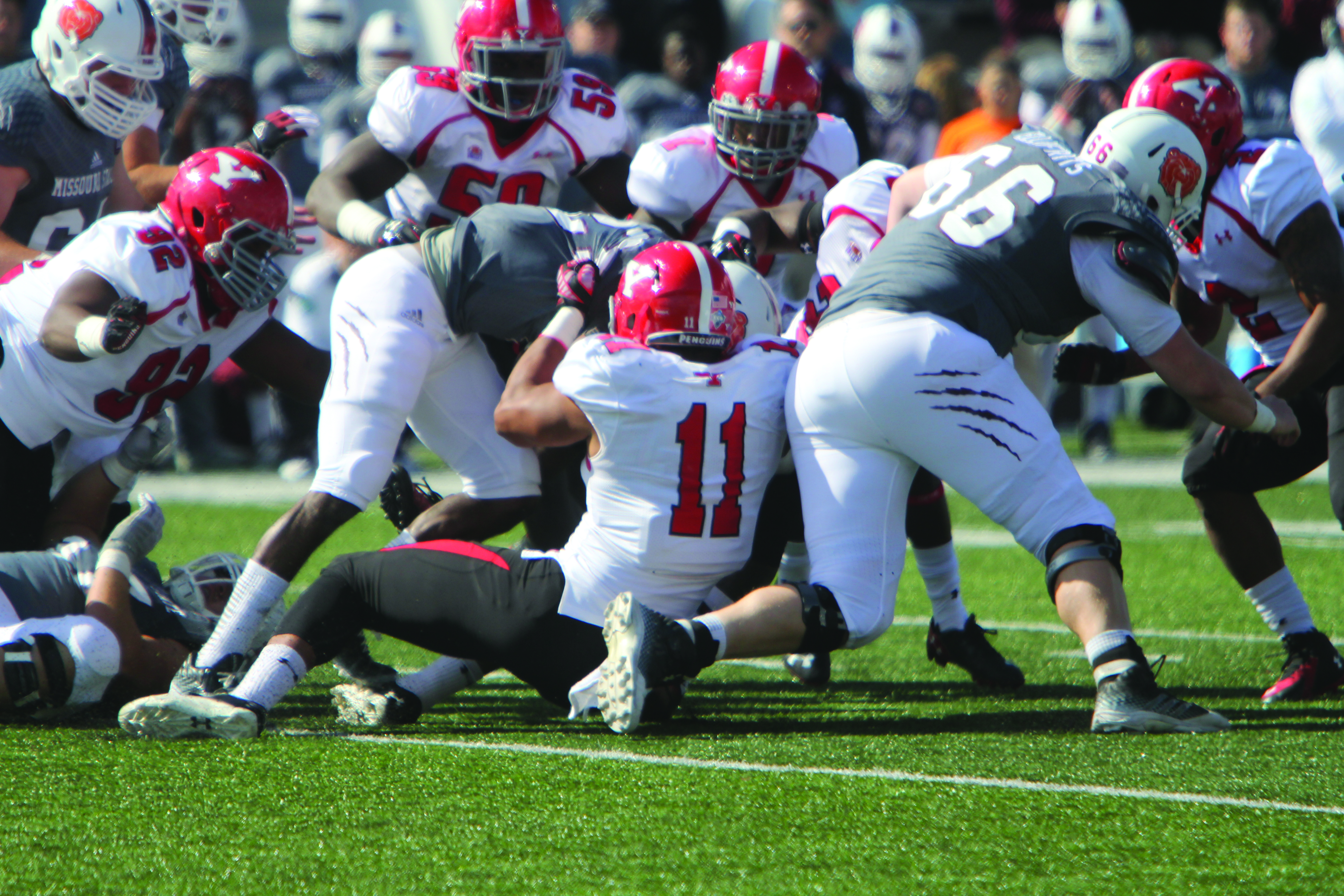 Youngstown State University's Derek Rivers (11) tackles Missouri State's Ryan Heaston (23) during Saturday's matchup at Missouri State University in Springfield, Missouri. The Penguins defeated the Bears 14-7, behind a strong defensive performance. Photo by Dustin Livesay/ The Jambar.