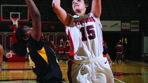Heidi Schlegel (15) attempts a shot during last season's opener against Virginia Commonwealth University. Schlegel finished second on the team in scoring with 31.6 points per game.Photo courtesy of YSU sports information.
