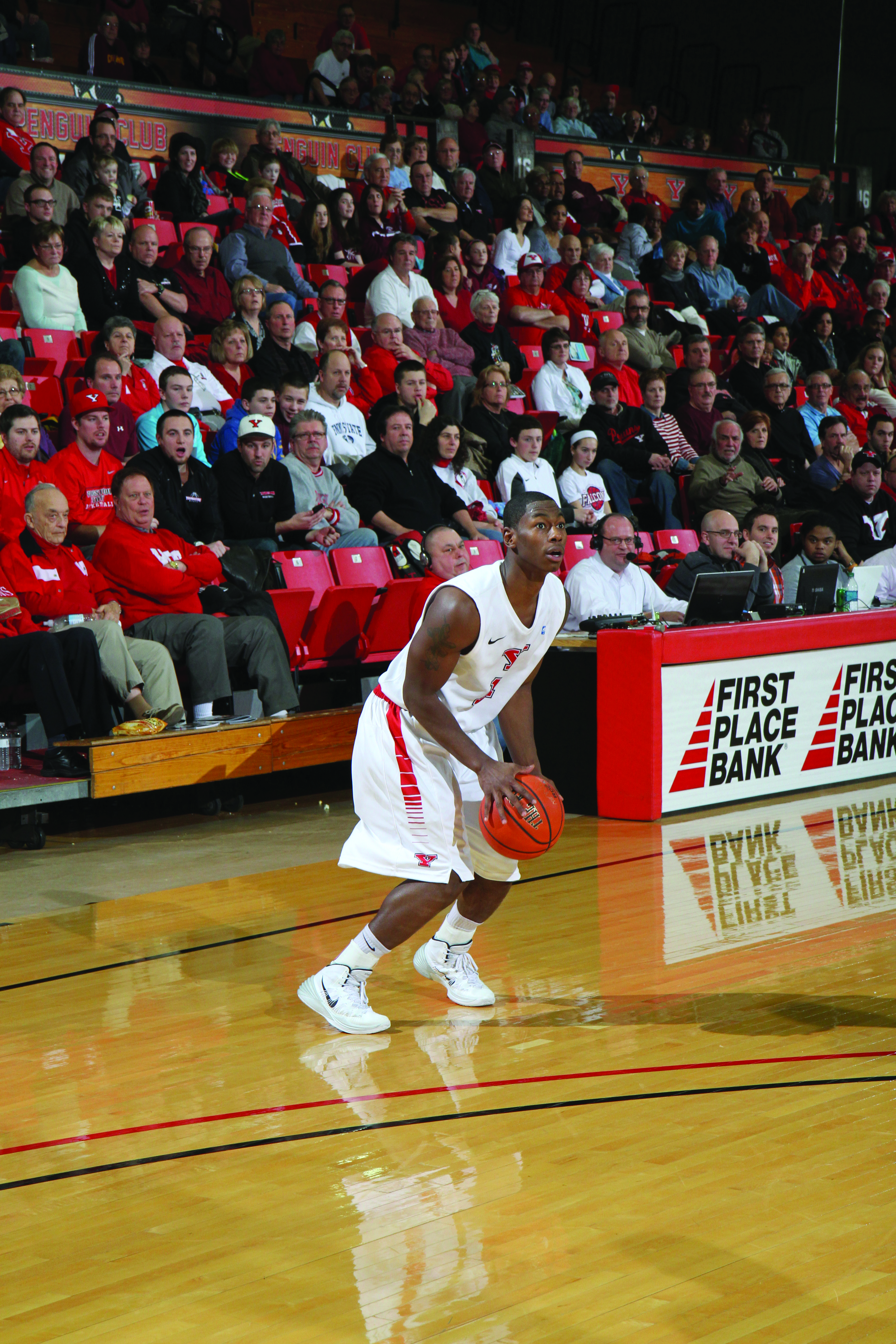 DJ Cole prepares to attempt a 3-point shot. Cole is one of two seniors on the roster and has emerged as a leader early this season. Photo courtesy of Sports Information.