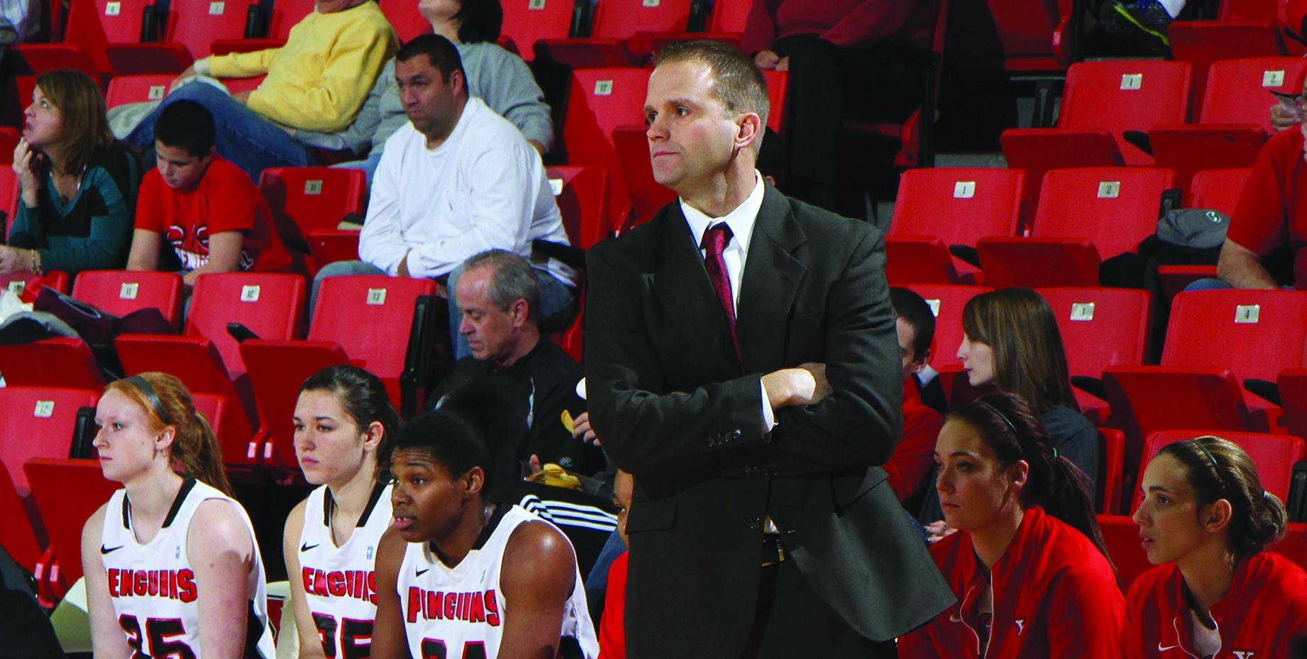 YSU Women's Basketball head coach John Barnes coaches the team on the sidelines mid-game during the first half of the season. Photo courtesy of Ron Stevens.
