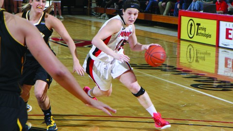 Senior forward Heidi Schlegel (15) drives into the lane during the Penguins' first game against the University of Milwaukee-Wisconsin back on Jan. 31. Schlegel finished with 24 points and nine rebounds. Photo courtesy of YSU Sports Information.