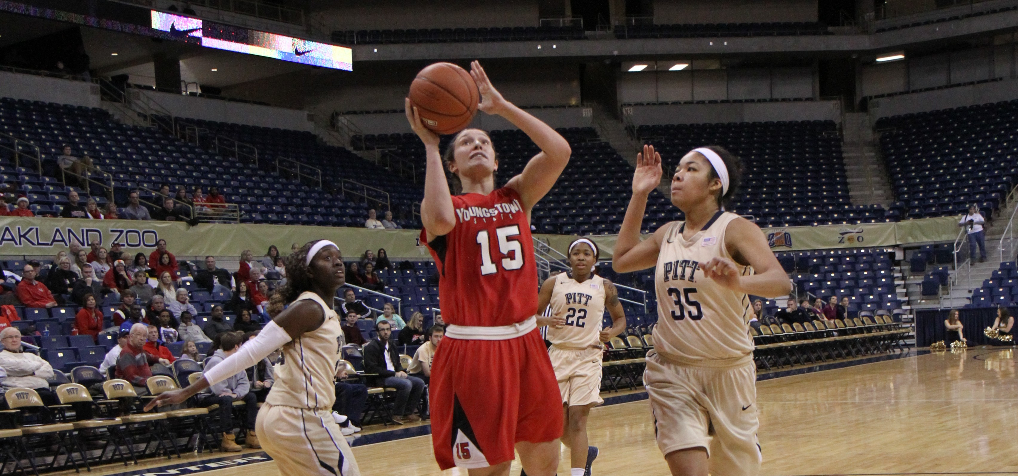 Senior Heidi Schlegel (15) drives for a layup during the Penguins' game against the University of Pittsburg on Dec. 21, 2014. Schlegel scored 20 points against the Golden Bears on Feb. 11, 2015. Photo courtesy of YSU Sports Information.