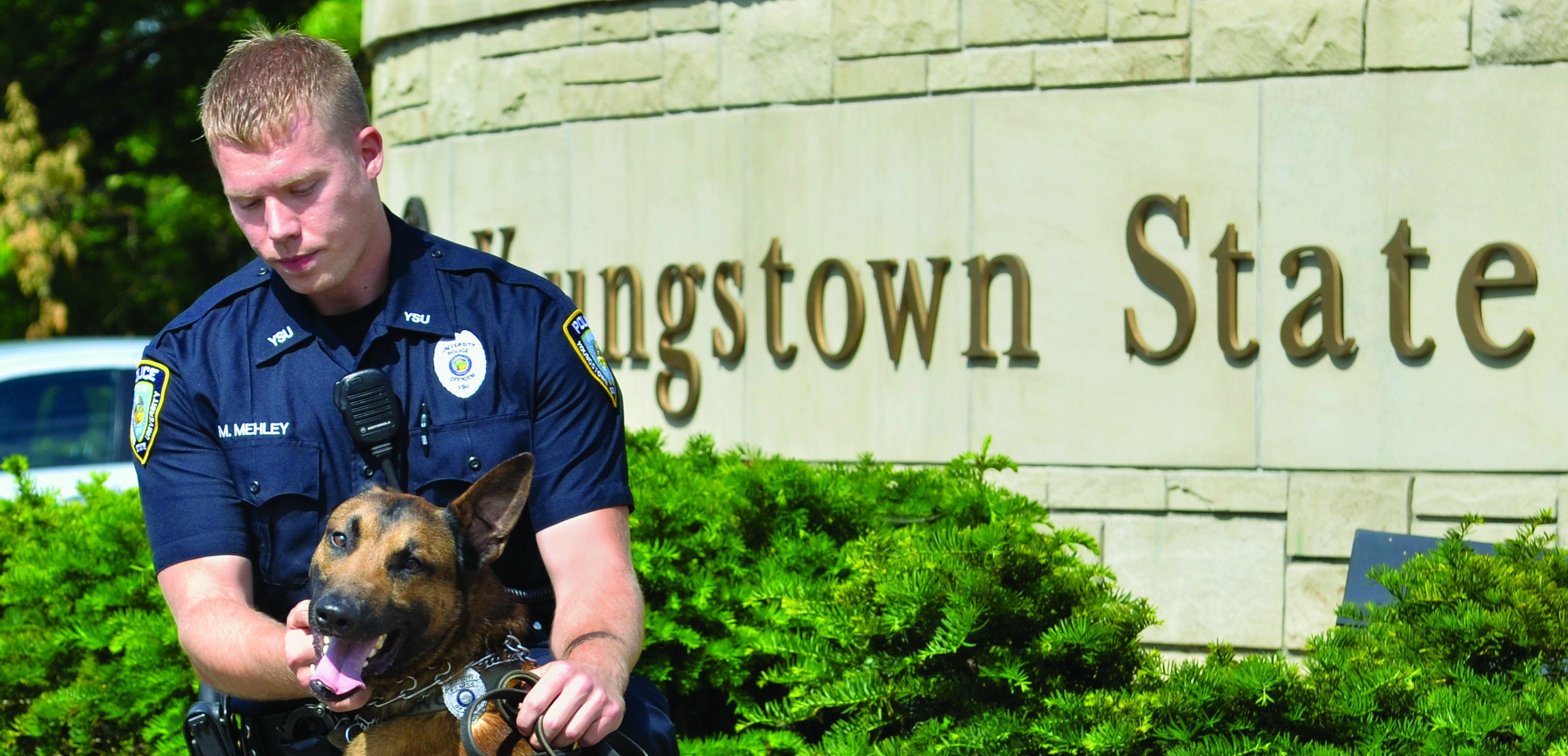 Pictured is Gino and Officer Mehley at the press conference in June 2014. Photo courtesy of YSUPD.
