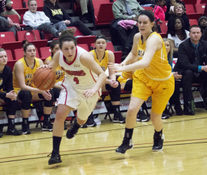 Youngstown State University shooting guard Nikki Arbanas (4) cuts toward the baseline.