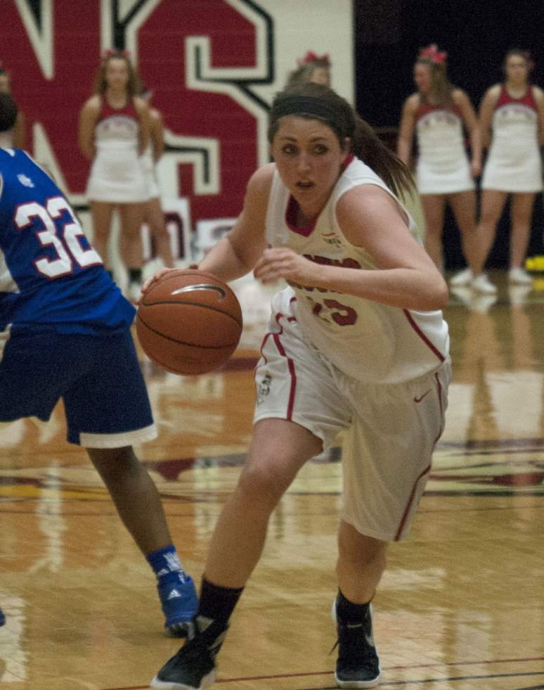 Youngstown State University guard Kelsea Newman drives to the basket.