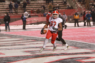 YSU running back looks into the camera after scoring on a 4-yard touchdown in YSU's eventual win