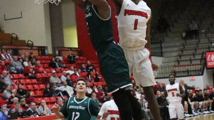Youngstown State University's Rahim Williams blocks a dunk attempt in the second half of YSU's loss to the University of Wisconsin-Green Bay.