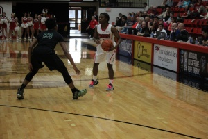Indiya Benjamin (3) looks for screen as Symone Simmons (23) guards her in a close YSU loss.