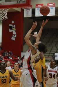 Youngstown State's Karen Flagg (14) puts up a jump shot while being defended by Valparaiso's Sharon Karungi (33) during the first half of Saturday afternoon's matchup at the Beeghly Center. Flagg had 14 points during YSU's 84-56 victory over the Crusaders.  Photo by Dustin Livesay     The Jambar.