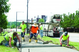 A fresh batch of concrete is smoothed outside Beeghly Hall in preparation for the fall semester.