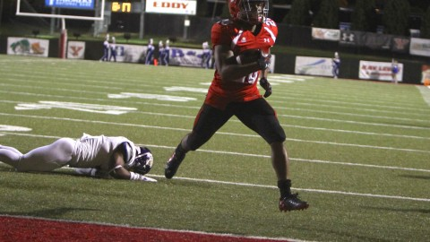 Youngstown State's Jody Webb (20) evades a tackle on the way to the endzone during the first half of Saturday nights matchup against Western Illinois at Stambaugh Stadium.   Photo by Dustin Livesay  | The Jambar