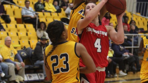 Youngstown State's Nikki Abranas (4) drives to the hoop while being defended by Kent State's Mikell Chinn (23) during the first half of Saturday night's matchup at the M.A.C Center on the campus of Kent State University.
