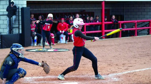 Pitcher Kayla Haslett (24) was called on to pinch hit with two outs in the bottom of the seventh inning. Haslett's infield single scored the game-winning run to lead YSU to a 2-1 win over Oakland University on April 1. Photo by Dan Hiner/ The Jambar.