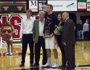 Youngstown State University forward Bobby Hain is honored by his family and head coach Jerry Slocum before the game.