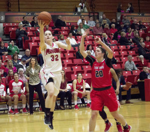 Youngstown State University guard Jenna Hirsch drives for a contested layup in the Penguins' win over Stony Brook University.