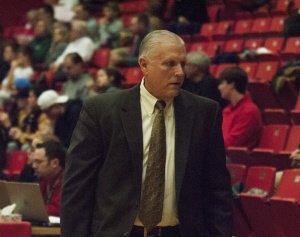 Jerry Slocum, Head Coach of the Youngstown State University men's basketball team, walks down the sidelines during a game.