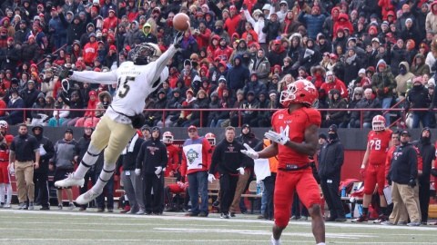 Youngstown State University receiver Damoun Patterson (4) runs under a deep touchdown pass.